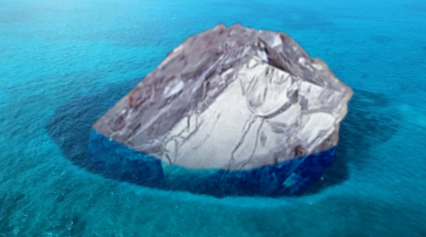 Uncut diamond partially submerged in Cay Sal bank blue hole.